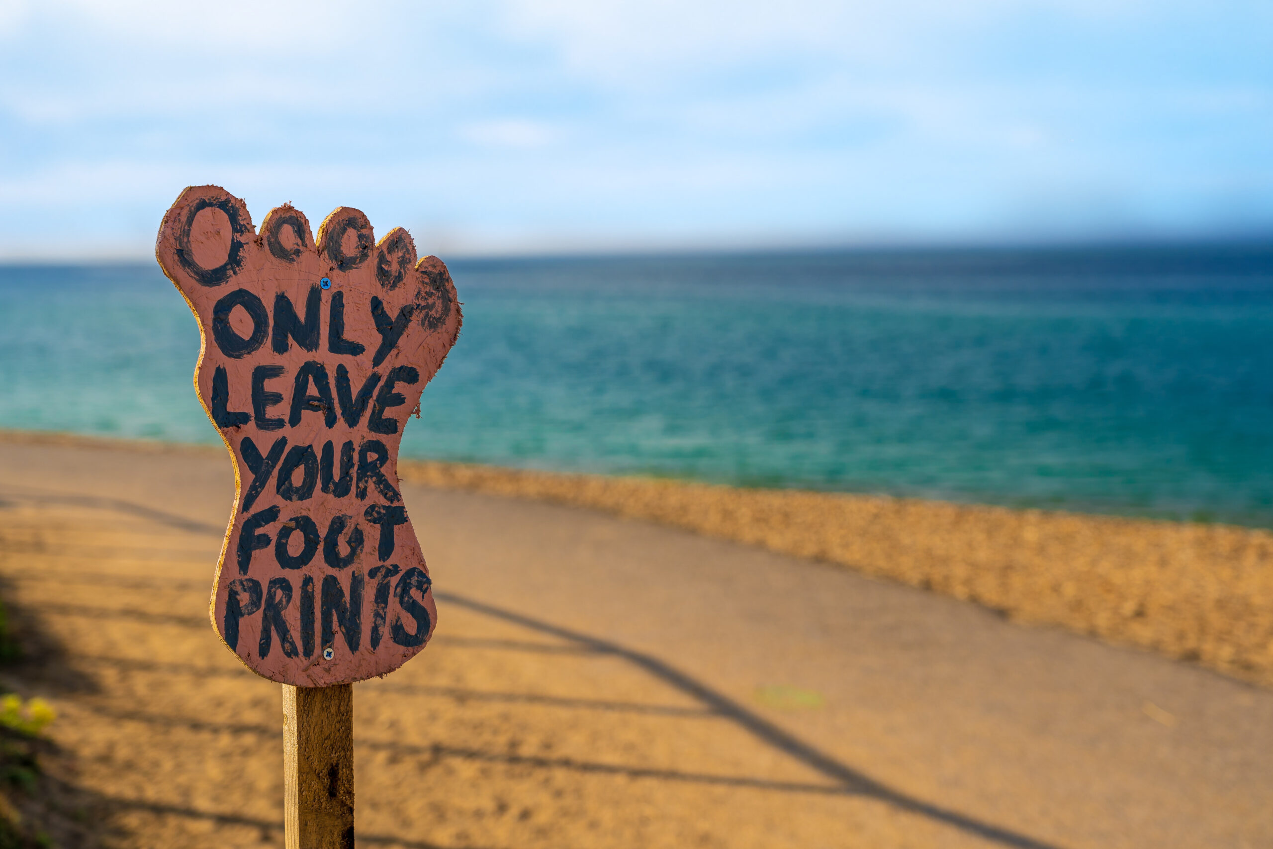 Foot Sign on the beach - only leave your footprints
